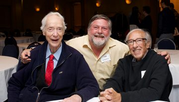 Group photo of Dr. Earl W. Davie, Dr. Ross MacGillivray and Dr. Eddy Fischer (from left to right) seated at a table during the Earl W. Davie Symposium in 2017.